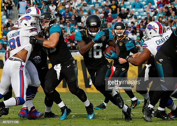 Denard Robinson of the Jacksonville Jaguars rushes for yardage during the game against the Buffalo Bills at EverBank Field on December 15 2013 in...
