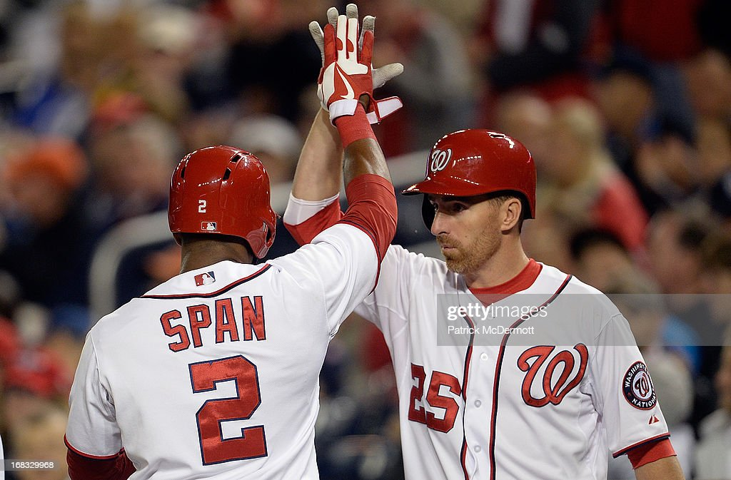 <a gi-track='captionPersonalityLinkClicked' href=/galleries/search?phrase=Denard+Span&family=editorial&specificpeople=835844 ng-click='$event.stopPropagation()'>Denard Span</a> #2 celebrates with <a gi-track='captionPersonalityLinkClicked' href=/galleries/search?phrase=Adam+LaRoche&family=editorial&specificpeople=216533 ng-click='$event.stopPropagation()'>Adam LaRoche</a> #25 of the Washington Nationals after scoring a run on a Bryce Harper's #34 sacrifice fly in the third inning against the Detroit Tigers during a game at Nationals Park on May 8, 2013 in Washington, DC.