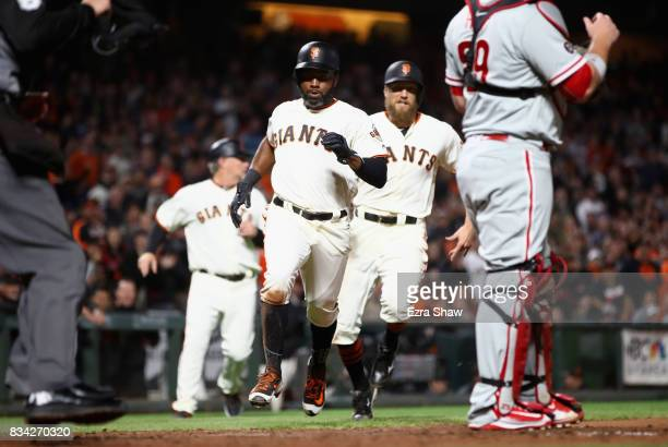 Denard Span is followed by Hunter Pence of the San Francisco Giants as they both score on a hit by Jarrett Parker of the San Francisco Giants in the...
