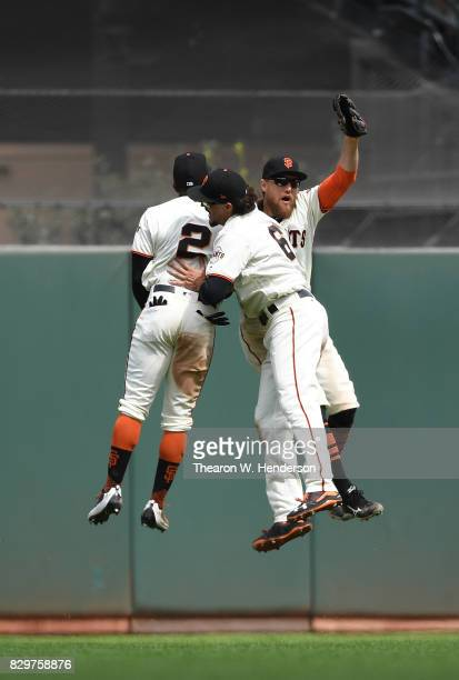 Denard Span Jarrett Parker and Hunter Pence of the San Francisco Giants celebrates defeating the Chicago Cubs 31 at ATT Park on August 9 2017 in San...