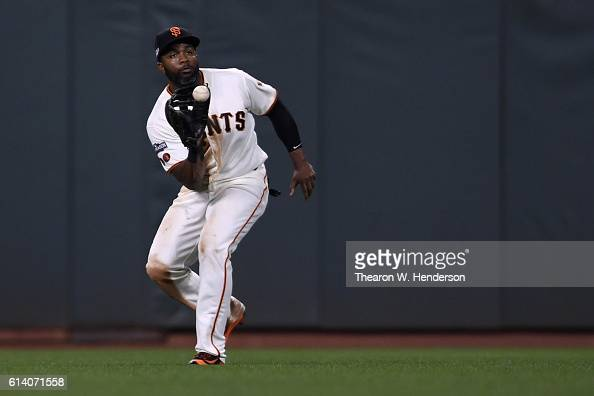 Denard Span of the San Francisco Giants catches a ball on a hit by Jason Heyward of the Chicago Cubs during Game Four of their National League...