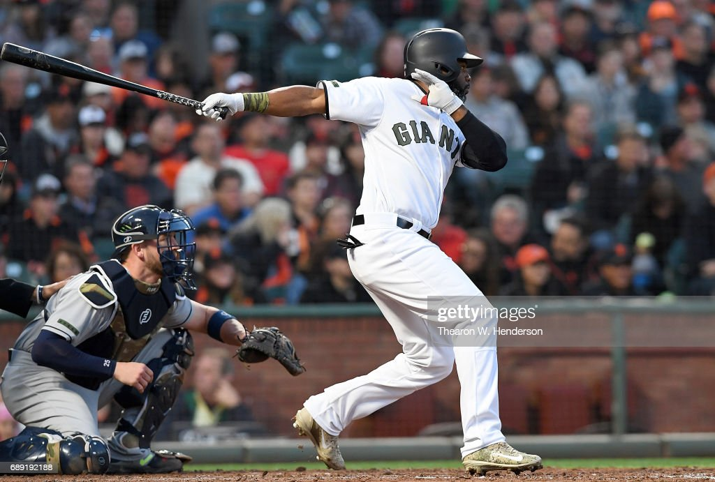 Denard Span #2 of the San Francisco Giants hits an rbi double scoring Mac Williamson #51 against the Atlanta Braves in the bottom of the fourth inning at AT&T Park on May 27, 2017 in San Francisco, California.