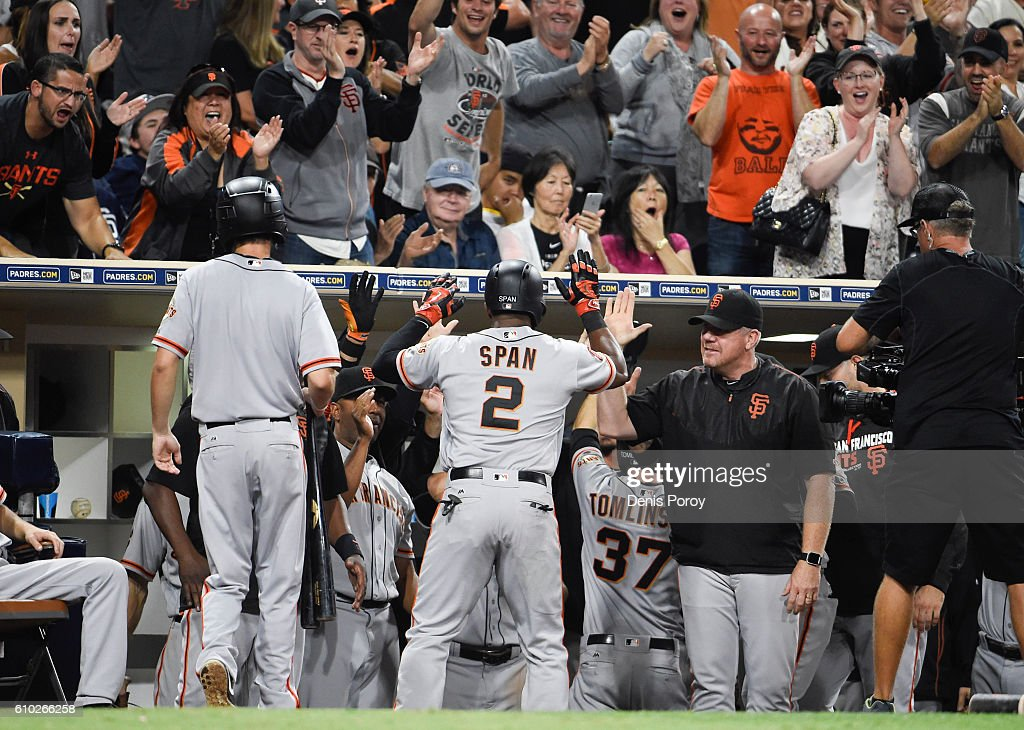 Denard Span #2 of the San Francisco Giants is congratulated after hitting a two-run home run during the tenth inning of a baseball game against the San Diego Padres at PETCO Park on September 24, 2016 in San Diego, California.