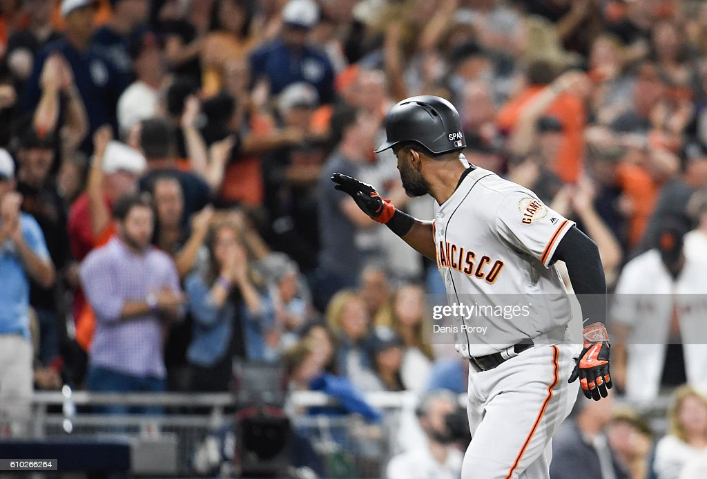 Denard Span #2 of the San Francisco Giants points to the dugout after hitting a two-run home run during the tenth inning of a baseball game against the San Diego Padres at PETCO Park on September 24, 2016 in San Diego, California.