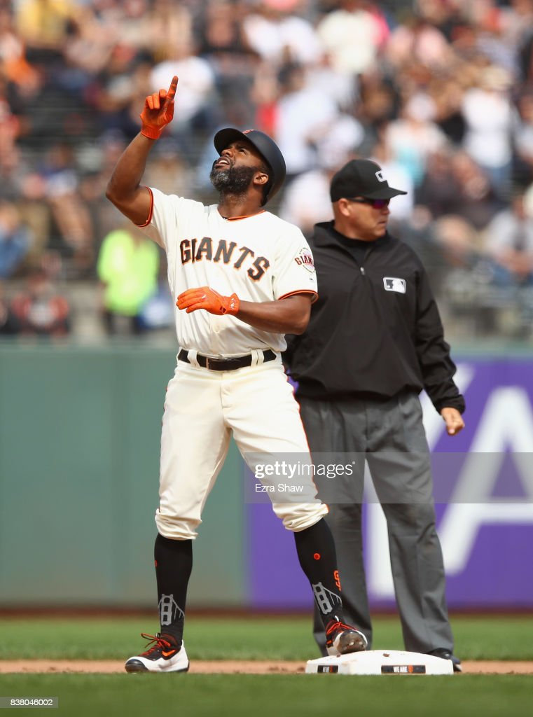 Denard Span #2 of the San Francisco Giants reacts after hitting a double in the seventh inning against the Milwaukee Brewers at AT&T Park on August 23, 2017 in San Francisco, California.