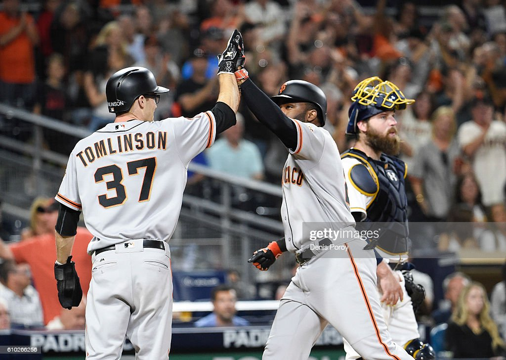 Denard Span #2 of the San Francisco Giants, right, is congratulated by Kelby Tomlinson #37 after hitting a two-run home run during the tenth inning of a baseball game against the San Diego Padres at PETCO Park on September 24, 2016 in San Diego, California.