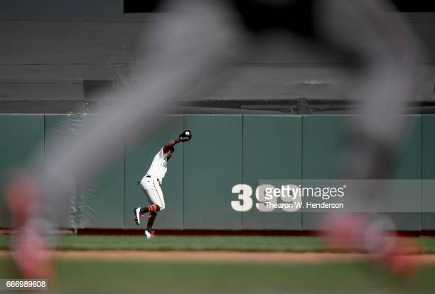 Denard Span of the San Francisco Giants runs down a fly ball off the bat of Jake Lamb of the Arizona Diamondbacks in the top of the seventh inning at...