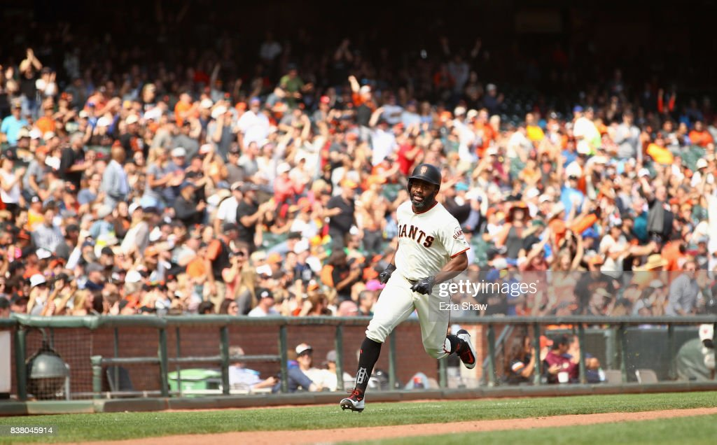 Denard Span #2 of the San Francisco Giants runs home to score on a hit by Jarrett Parker #6 in the seventh inning of their game against the Milwaukee Brewers at AT&T Park on August 23, 2017 in San Francisco, California.