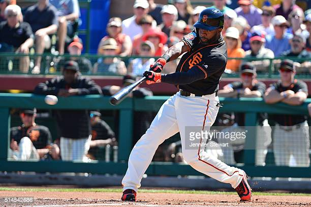 Denard Span of the San Francisco Giants singles in the first inning against the Colorado Rockies during the spring training game at Scottsdale...