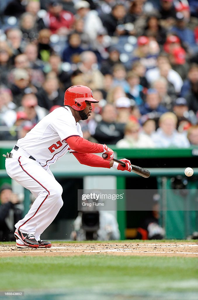 Denard Span #2 of the Washington Nationals bunts for a single in the third inning against the Miami Marlins at Nationals Park on April 4, 2013 in Washington, DC.