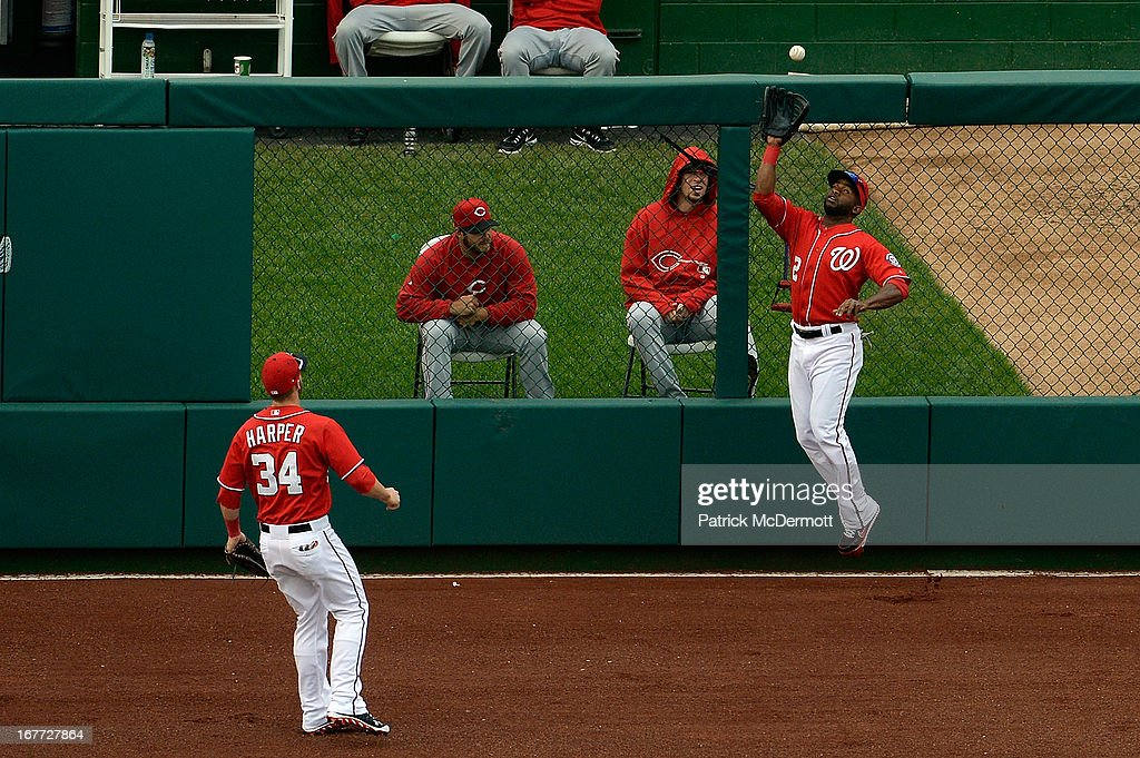 <a gi-track='captionPersonalityLinkClicked' href=/galleries/search?phrase=Denard+Span&family=editorial&specificpeople=835844 ng-click='$event.stopPropagation()'>Denard Span</a> #2 of the Washington Nationals catches a fly ball hit by Joey Votto #19 of the Cincinnati Reds to end the top of the fourth inning during a game at Nationals Park on April 28, 2013 in Washington, DC.