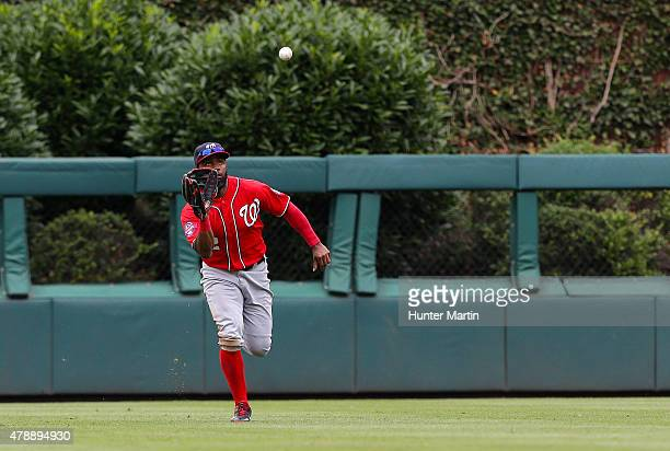 Denard Span of the Washington Nationals catches a fly ball in the ninth inning during game one of a doubleheader against the Philadelphia Phillies at...