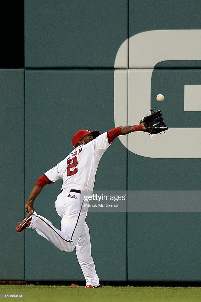 <a gi-track='captionPersonalityLinkClicked' href=/galleries/search?phrase=Denard+Span&family=editorial&specificpeople=835844 ng-click='$event.stopPropagation()'>Denard Span</a> #2 of the Washington Nationals catches a line ball hit by Logan Schafer #22 of the Milwaukee Brewers in the ninth inning during a game at Nationals Park on July 3, 2013 in Washington, DC.
