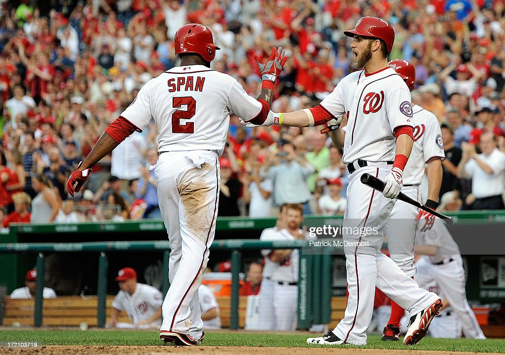 <a gi-track='captionPersonalityLinkClicked' href=/galleries/search?phrase=Denard+Span&family=editorial&specificpeople=835844 ng-click='$event.stopPropagation()'>Denard Span</a> #2 of the Washington Nationals celebrates with <a gi-track='captionPersonalityLinkClicked' href=/galleries/search?phrase=Bryce+Harper&family=editorial&specificpeople=5926486 ng-click='$event.stopPropagation()'>Bryce Harper</a> #34 after scoring on a two run RBI double by Jayson Werth #28 in the third inning during a game at Nationals Park on July 1, 2013 in Washington, DC.