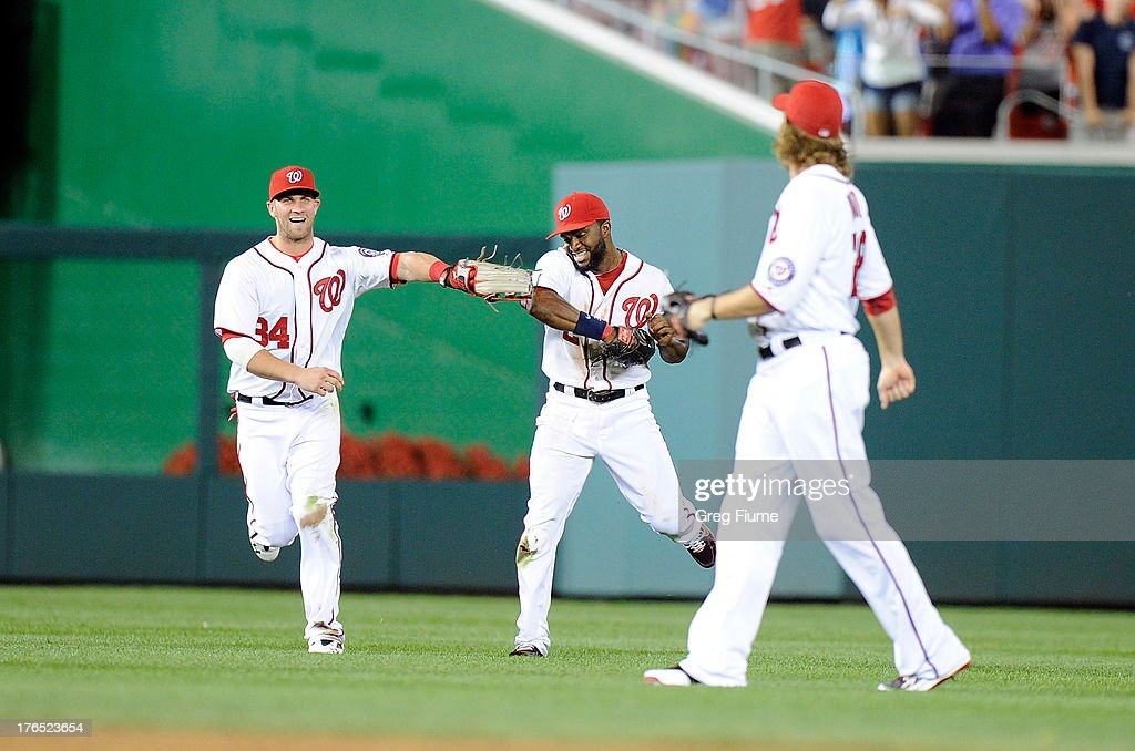 <a gi-track='captionPersonalityLinkClicked' href=/galleries/search?phrase=Denard+Span&family=editorial&specificpeople=835844 ng-click='$event.stopPropagation()'>Denard Span</a> #2 of the Washington Nationals celebrates with <a gi-track='captionPersonalityLinkClicked' href=/galleries/search?phrase=Bryce+Harper&family=editorial&specificpeople=5926486 ng-click='$event.stopPropagation()'>Bryce Harper</a> #34 and <a gi-track='captionPersonalityLinkClicked' href=/galleries/search?phrase=Jayson+Werth&family=editorial&specificpeople=206490 ng-click='$event.stopPropagation()'>Jayson Werth</a> #28 after a 6-5 victory against the San Francisco Giants at Nationals Park on August 14, 2013 in Washington, DC.