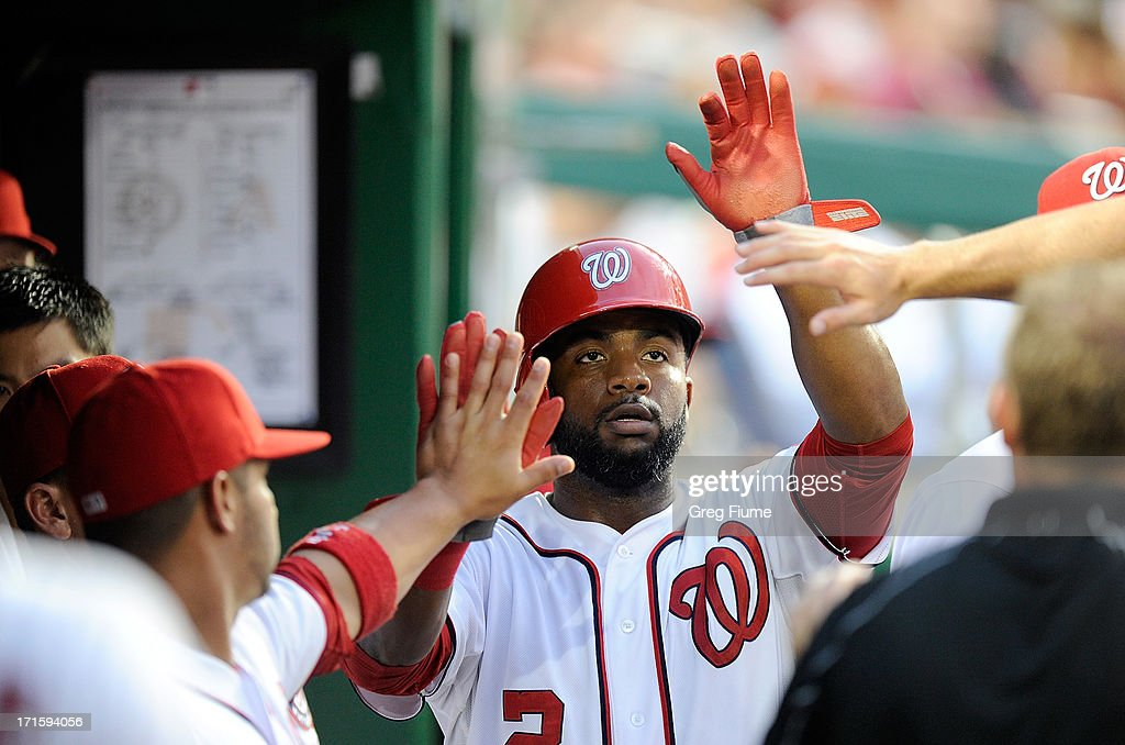 <a gi-track='captionPersonalityLinkClicked' href=/galleries/search?phrase=Denard+Span&family=editorial&specificpeople=835844 ng-click='$event.stopPropagation()'>Denard Span</a> #2 of the Washington Nationals celebrates with teammates after scoring in the fifth inning against the Arizona Diamondbacks at Nationals Park on June 26, 2013 in Washington, DC.