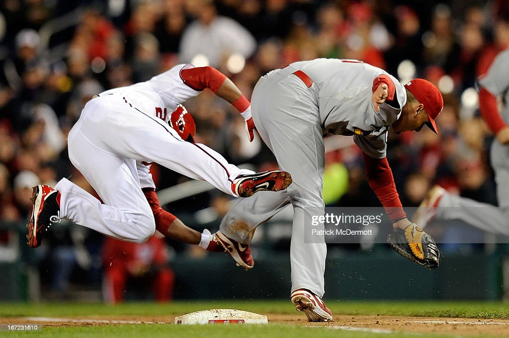 <a gi-track='captionPersonalityLinkClicked' href=/galleries/search?phrase=Denard+Span&family=editorial&specificpeople=835844 ng-click='$event.stopPropagation()'>Denard Span</a> #2 of the Washington Nationals collides with <a gi-track='captionPersonalityLinkClicked' href=/galleries/search?phrase=Allen+Craig&family=editorial&specificpeople=4405049 ng-click='$event.stopPropagation()'>Allen Craig</a> #21 of the St. Louis Cardinals at first base after hitting a single in the eighth inning during a game at Nationals Park on April 22, 2013 in Washington, DC.