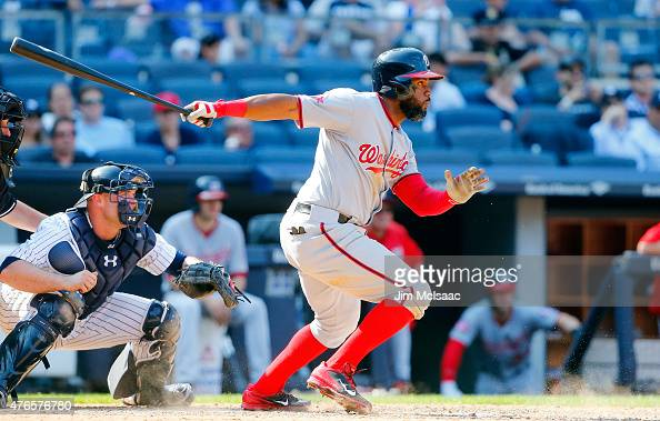 Denard Span of the Washington Nationals follows through on an eleventh inning RBI infield base hit against the New York Yankees at Yankee Stadium on...