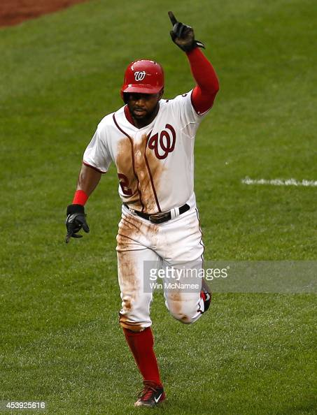 Denard Span of the Washington Nationals heads to home plate to score the winning run against the Arizona Diamondbacks in the ninth inning at...