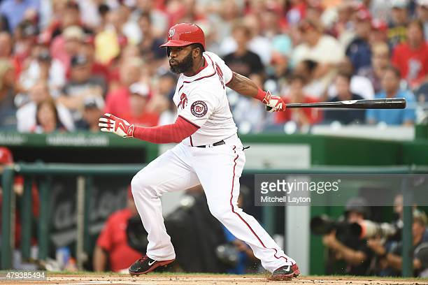Denard Span of the Washington Nationals hits a lead off single in the first inning during a baseball game against the San Francisco Giants at...