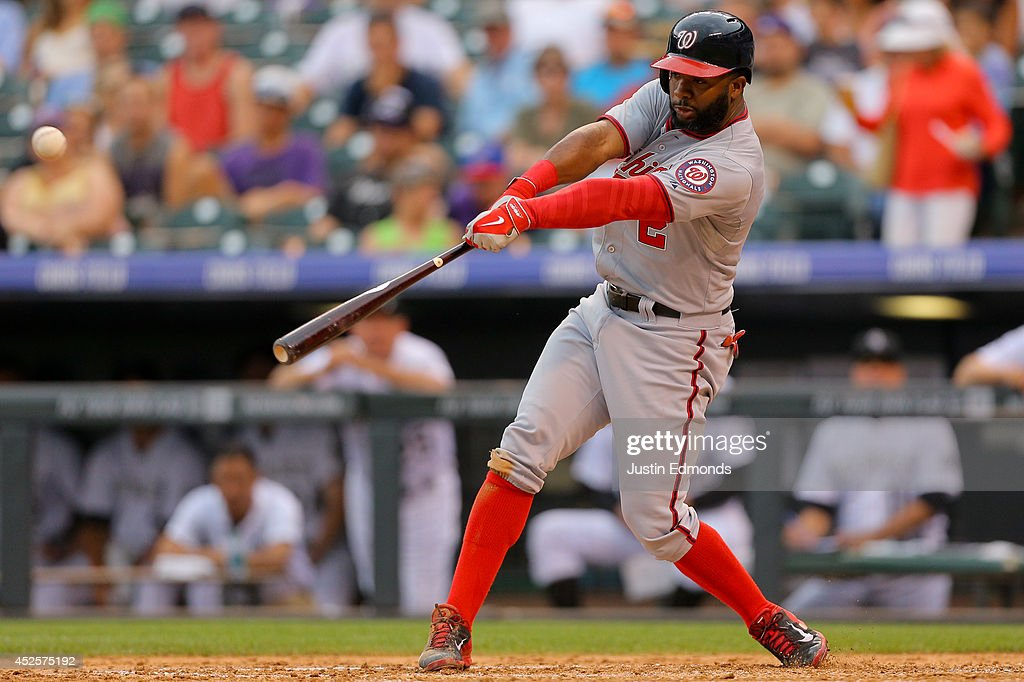 <a gi-track='captionPersonalityLinkClicked' href=/galleries/search?phrase=Denard+Span&family=editorial&specificpeople=835844 ng-click='$event.stopPropagation()'>Denard Span</a> #2 of the Washington Nationals hits an RBI single during the fifth inning against the Colorado Rockies at Coors Field on July 23, 2014 in Denver, Colorado. The Rockies defeated the Nationals 6-4.