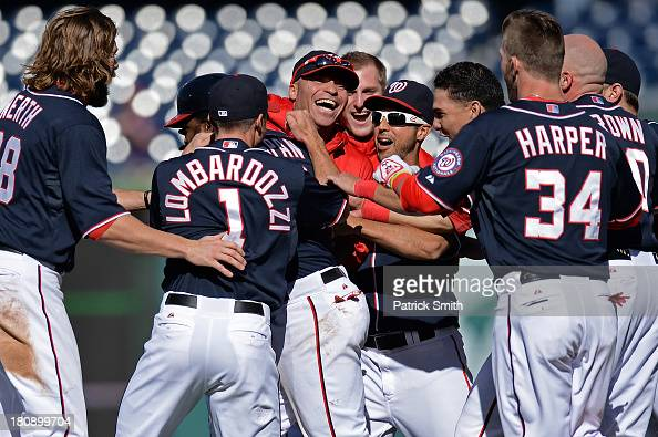 Denard Span of the Washington Nationals is mobbed by teammates after his hit drove in the gamewinning run against the Atlanta Braves in the ninth...