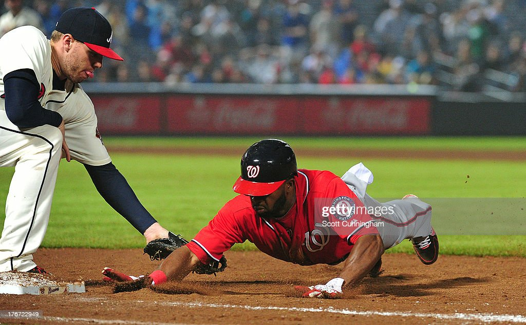 <a gi-track='captionPersonalityLinkClicked' href=/galleries/search?phrase=Denard+Span&family=editorial&specificpeople=835844 ng-click='$event.stopPropagation()'>Denard Span</a> #2 of the Washington Nationals is picked off first base by <a gi-track='captionPersonalityLinkClicked' href=/galleries/search?phrase=Freddie+Freeman&family=editorial&specificpeople=5743987 ng-click='$event.stopPropagation()'>Freddie Freeman</a> #5 of the Atlanta Braves at Turner Field on August 17, 2013 in Atlanta, Georgia.