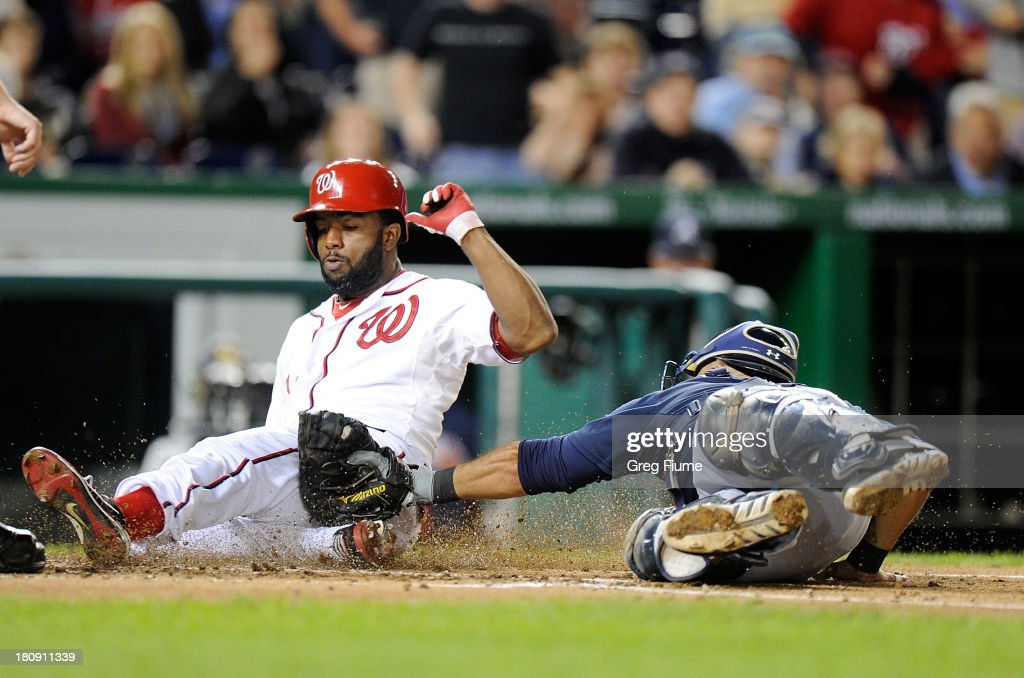 <a gi-track='captionPersonalityLinkClicked' href=/galleries/search?phrase=Denard+Span&family=editorial&specificpeople=835844 ng-click='$event.stopPropagation()'>Denard Span</a> #2 of the Washington Nationals is tagged out at home plate in the third inning by <a gi-track='captionPersonalityLinkClicked' href=/galleries/search?phrase=Gerald+Laird&family=editorial&specificpeople=228949 ng-click='$event.stopPropagation()'>Gerald Laird</a> #11 of the Atlanta Braves at Nationals Park on September 17, 2013 in Washington, DC.