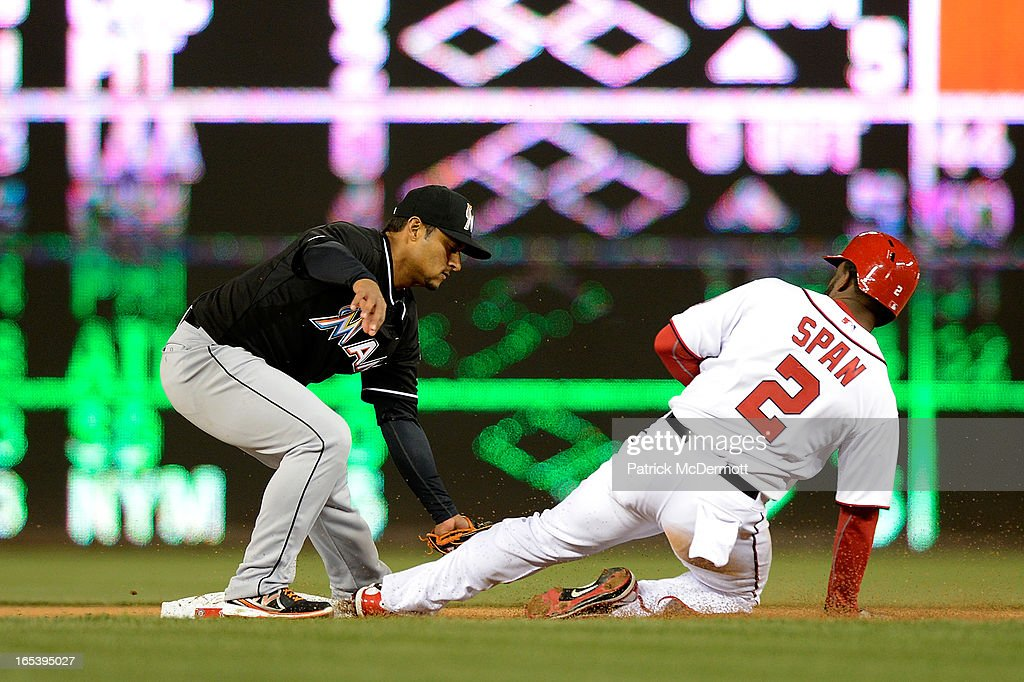 <a gi-track='captionPersonalityLinkClicked' href=/galleries/search?phrase=Denard+Span&family=editorial&specificpeople=835844 ng-click='$event.stopPropagation()'>Denard Span</a> #2 of the Washington Nationals is tagged out by Donovan Solano #17 of the Miami Marlins as he tries to steal second base in the fifth inning during a game at Nationals Park on April 3, 2013 in Washington, DC.
