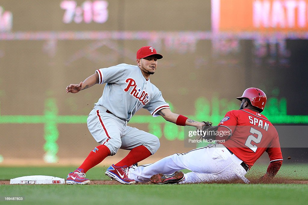 Denard Span #2 of the Washington Nationals is tagged out by Freddy Galvis #13 of the Philadelphia Phillies after attempting to steal second base in the first inning during a game at Nationals Park on May 25, 2013 in Washington, DC.