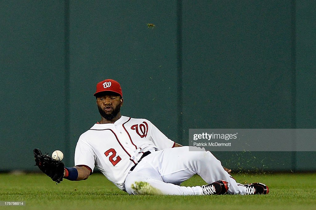 <a gi-track='captionPersonalityLinkClicked' href=/galleries/search?phrase=Denard+Span&family=editorial&specificpeople=835844 ng-click='$event.stopPropagation()'>Denard Span</a> #2 of the Washington Nationals is unable to catch a single hit by B.J. Upton #2 of the Atlanta Braves in the sixth inning during a game at Nationals Park on August 7, 2013 in Washington, DC.
