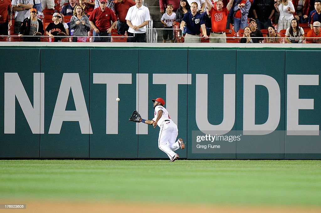 <a gi-track='captionPersonalityLinkClicked' href=/galleries/search?phrase=Denard+Span&family=editorial&specificpeople=835844 ng-click='$event.stopPropagation()'>Denard Span</a> #2 of the Washington Nationals makes a diving catch to end the game against Hunter Pence #8 (not pictured) of the San Francisco Giants at Nationals Park on August 14, 2013 in Washington, DC. Washington won the game 6-5.
