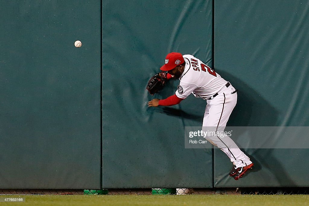Denard Span of the Washington Nationals misses an RBI triple hit by David DeJesus of the Tampa Bay Rays in the sixth inning at Nationals Park on June...