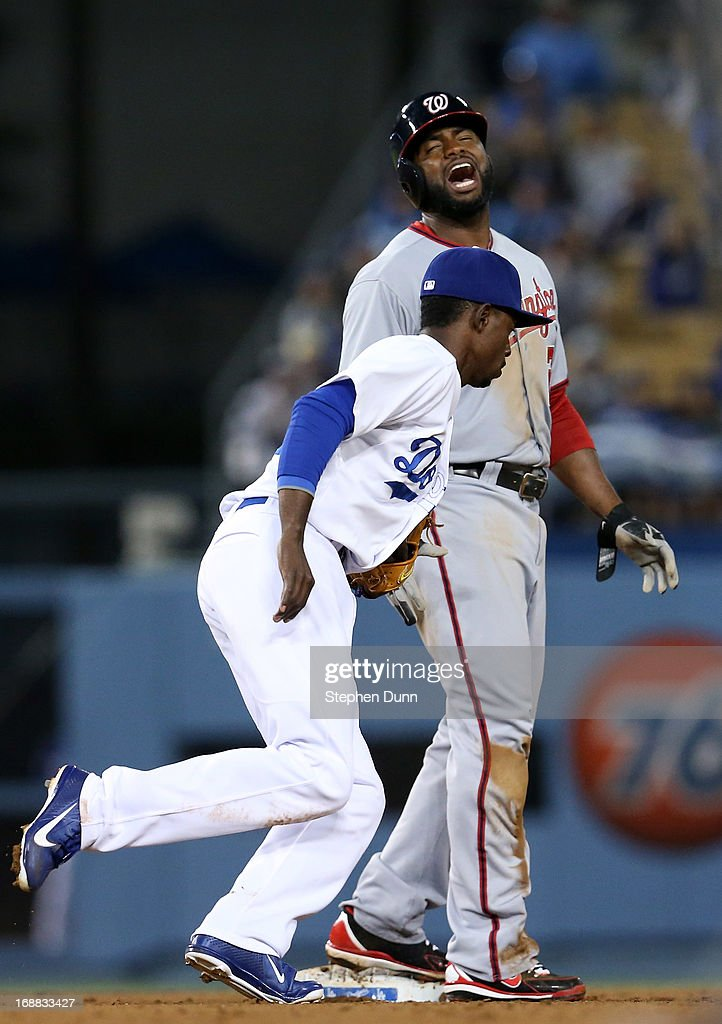 <a gi-track='captionPersonalityLinkClicked' href=/galleries/search?phrase=Denard+Span&family=editorial&specificpeople=835844 ng-click='$event.stopPropagation()'>Denard Span</a> #2 of the Washington Nationals reacts after being called out attempting to steal second on a tag by <a gi-track='captionPersonalityLinkClicked' href=/galleries/search?phrase=Dee+Gordon&family=editorial&specificpeople=7091343 ng-click='$event.stopPropagation()'>Dee Gordon</a> #9 of the Los Angeles Dodgers to end the top of the seventh inning at Dodger Stadium on May 15, 2013 in Los Angeles, California.