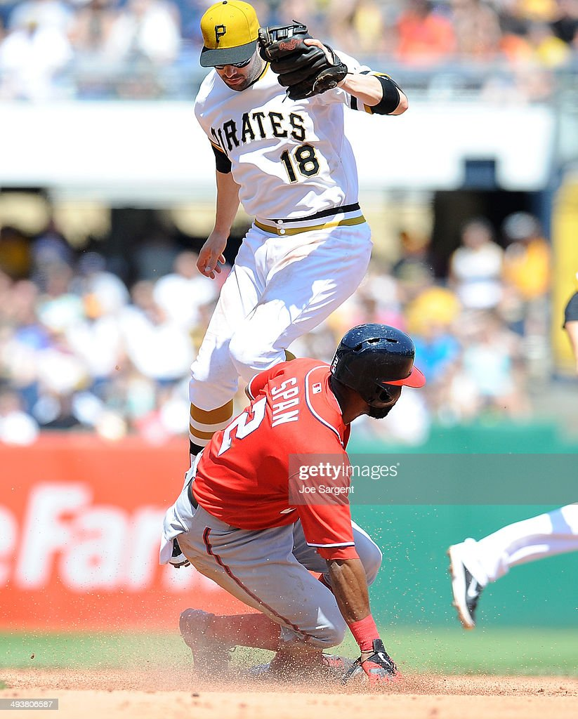 Denard Span #2 of the Washington Nationals safely steals second base in front of Neil Walker #18 of the Pittsburgh Pirates during the fifth inning on May 25, 2014 at PNC Park in Pittsburgh, Pennsylvania.