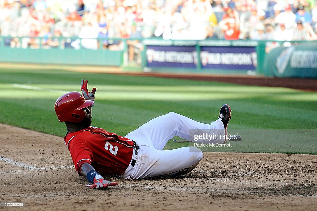 <a gi-track='captionPersonalityLinkClicked' href=/galleries/search?phrase=Denard+Span&family=editorial&specificpeople=835844 ng-click='$event.stopPropagation()'>Denard Span</a> #2 of the Washington Nationals scores a run on a sacrifice fly hit by Bryce Harper #34 in the seventh inning during a game against the San Diego Padres at Nationals Park on July 6, 2013 in Washington, DC.