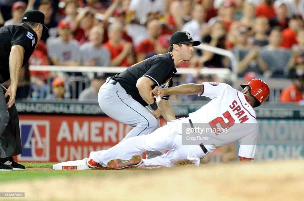 <a gi-track='captionPersonalityLinkClicked' href=/galleries/search?phrase=Denard+Span&family=editorial&specificpeople=835844 ng-click='$event.stopPropagation()'>Denard Span</a> #2 of the Washington Nationals slides safely into third base in the sixth inning ahead of the tag of Ed Lucas #59 of the Miami Marlins at Nationals Park on September 20, 2013 in Washington, DC.