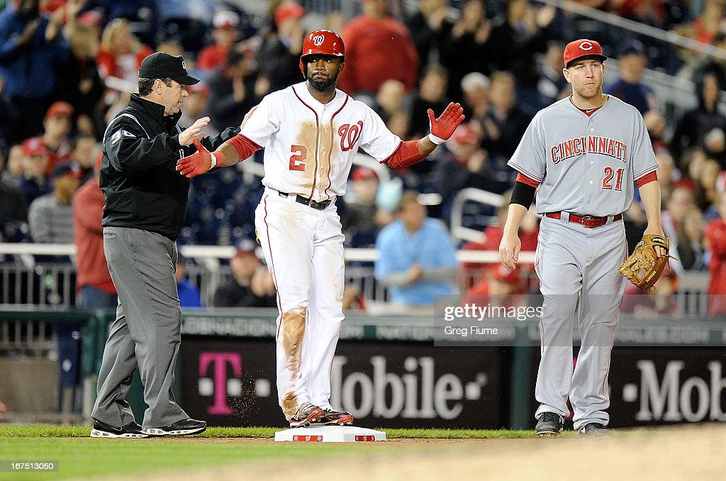 <a gi-track='captionPersonalityLinkClicked' href=/galleries/search?phrase=Denard+Span&family=editorial&specificpeople=835844 ng-click='$event.stopPropagation()'>Denard Span</a> #2 of the Washington Nationals stands on third base after hitting a triple in the eighth inning against the Cincinnati Reds at Nationals Park on April 25, 2013 in Washington, DC.