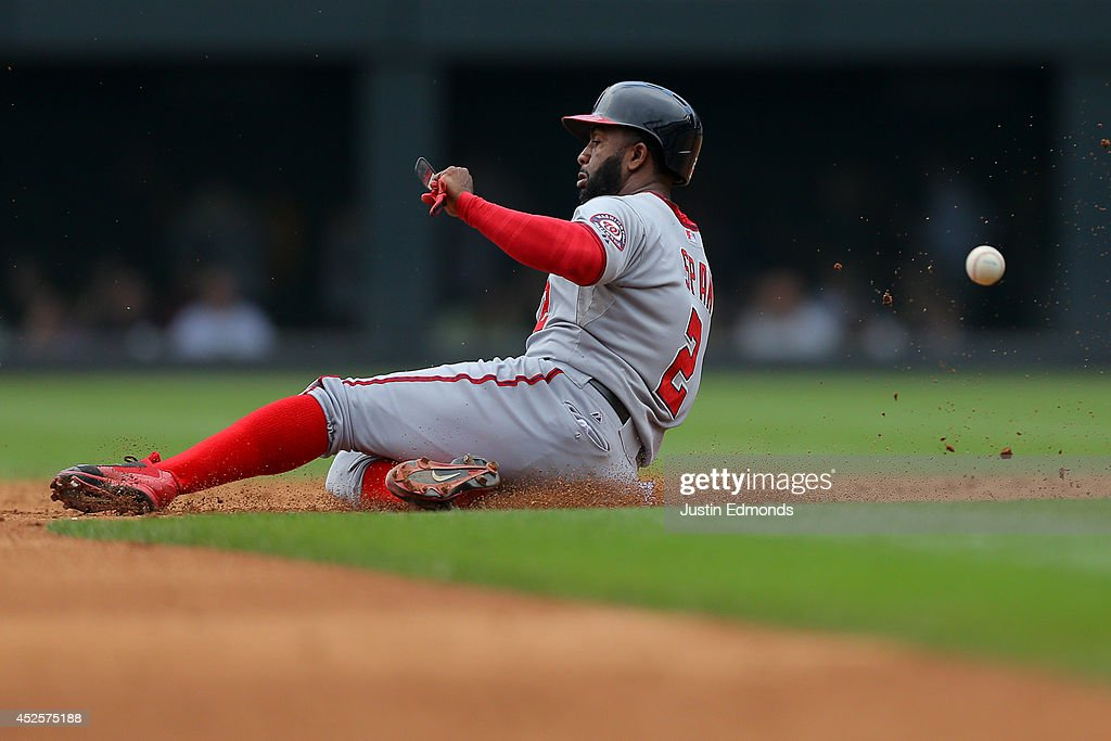 <a gi-track='captionPersonalityLinkClicked' href=/galleries/search?phrase=Denard+Span&family=editorial&specificpeople=835844 ng-click='$event.stopPropagation()'>Denard Span</a> #2 of the Washington Nationals steals second base ahead of the throw during the third inning against the Colorado Rockies at Coors Field on July 23, 2014 in Denver, Colorado. The Rockies defeated the Nationals 6-4.