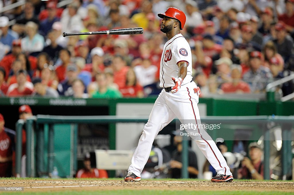 <a gi-track='captionPersonalityLinkClicked' href=/galleries/search?phrase=Denard+Span&family=editorial&specificpeople=835844 ng-click='$event.stopPropagation()'>Denard Span</a> #2 of the Washington Nationals tosses his bat after striking out to end the eighth inning against the Atlanta Braves at Nationals Park on August 6, 2013 in Washington, DC.