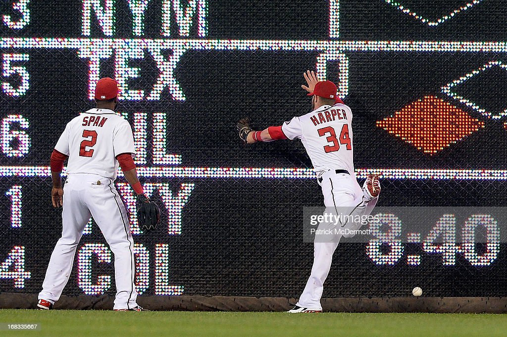 <a gi-track='captionPersonalityLinkClicked' href=/galleries/search?phrase=Denard+Span&family=editorial&specificpeople=835844 ng-click='$event.stopPropagation()'>Denard Span</a> #2 watches <a gi-track='captionPersonalityLinkClicked' href=/galleries/search?phrase=Bryce+Harper&family=editorial&specificpeople=5926486 ng-click='$event.stopPropagation()'>Bryce Harper</a> #34 of the Washington Nationals fail to catch a double hit by Prince Fielder #28 of the Detroit Tigers in the second inning during a game at Nationals Park on May 8, 2013 in Washington, DC.