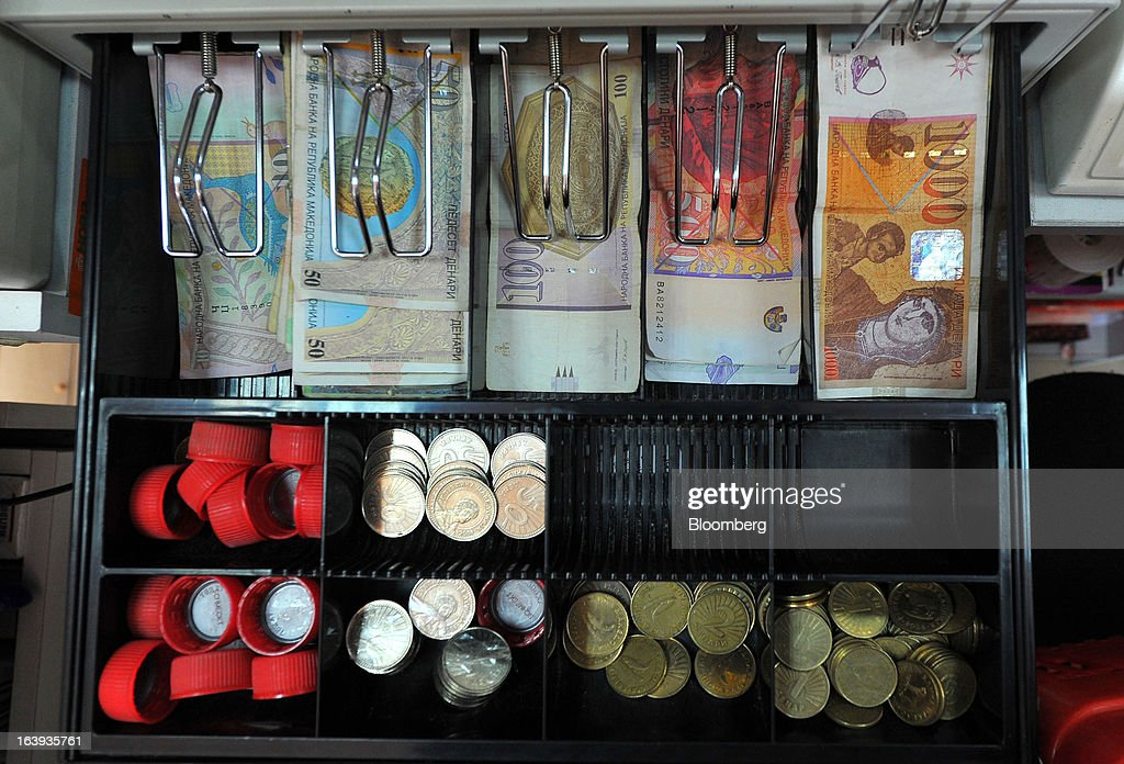 Denari currency banknotes and coins sit in a cash register inside a supermarket in central Skopje, Macedonia, on Saturday, March 16, 2013. Macedonia's economy contracted by a real 0.3% on the year in 2012, compared to a growth of 2.8% a year earlier, an estimate released by the country's statistics office showed. Photographer: Oliver Bunic/Bloomberg via Getty Images