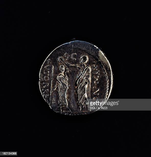 A denarius issued by the Triumvir Marco Emilio Lepido depicting him crowning Ptolemy V Epiphanes of Egypt Roman coins 1st century BC