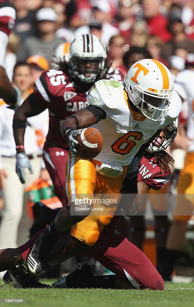 Denarius Moore #6 of the Tennessee Volunteers is tackled by Melvin Ingram #6 of the South Carolina Gamecocks during their game at Williams-Brice Stadium on October 30, 2010 in Columbia, South Carolina.