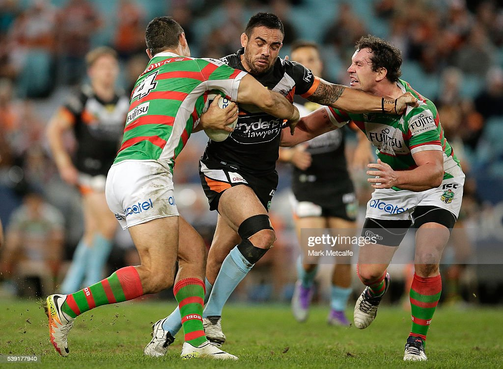 Dene Halatau of the Tigers is tackled during the round 14 NRL match between the Wests Tigers and the South Sydney Rabbitohs at ANZ Stadium on June 10, 2016 in Sydney, Australia.
