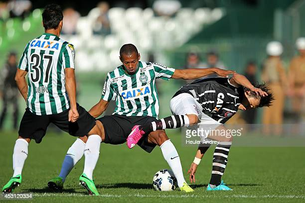 Dener of Coritiba competes for the ball with Angel Romero of Corinthians during the match between Coritiba and Corinthians for the Brazilian Series A...