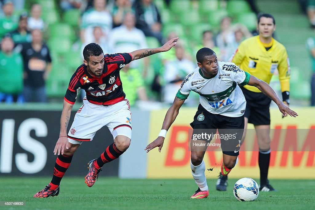 Dener of Coritiba competes for the ball with Canteros of Flamengo during the match between Coritiba and Flamengo for the Brazilian Series A 2014 at Couto Pereira stadium on August 17, 2014 in Curitiba, Brazil.