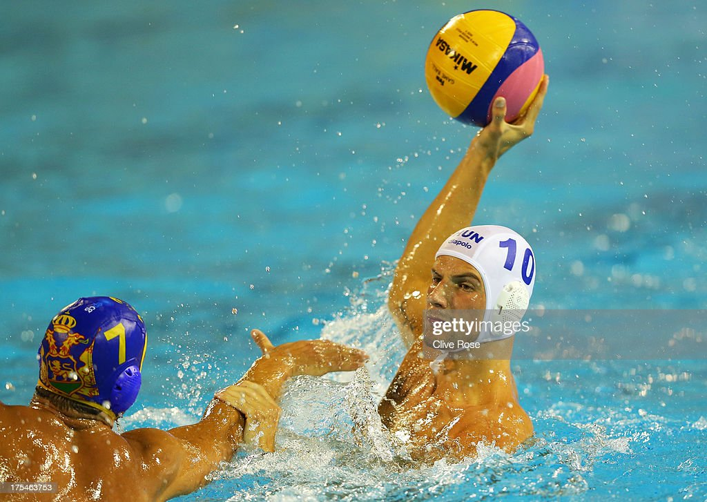 Denes Varga looks to offload the ball during the Men's Water Polo Men's Gold Medal Match between Hungary and Montenegro on day fifteen of the 15th FINA World Championships at Piscines Bernat Picornell on August 3, 2013 in Barcelona, Spain.