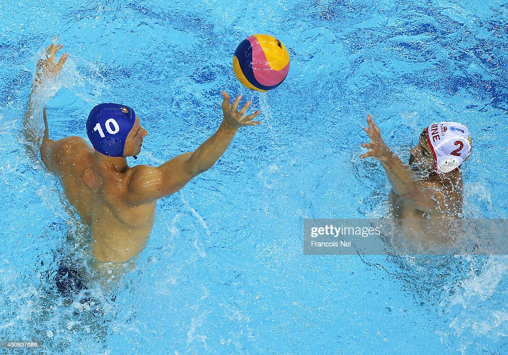 Denes Varga of Hungary competes for the ball with Drasko Brguljan of Montenegro during the Fina Men's Water Polo World League Super Semi Final match between Hungary and Montenegro at the Hamdan Sports Complex on June 20, 2014 in Dubai, United Arab Emirates.