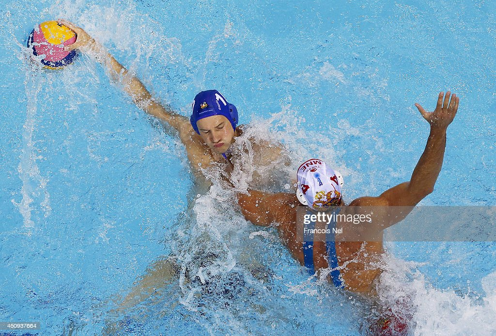 Denes Varga of Hungary conrtols the ball against Antonio Petrovic of Montenegro during the Fina Men's Water Polo World League Super Semi Final match between Hungary and Montenegro at the Hamdan Sports Complex on June 20, 2014 in Dubai, United Arab Emirates.